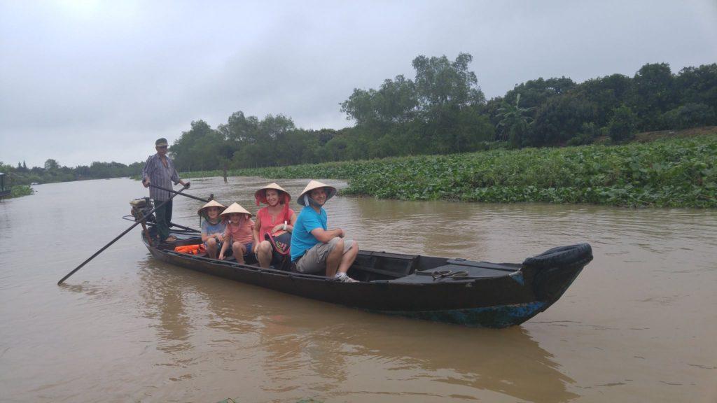 cruising through a canal in Caibe Mekong delta