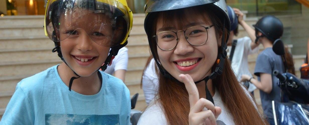 A Happy family on Saigon Private Food Tour with Xinchao
