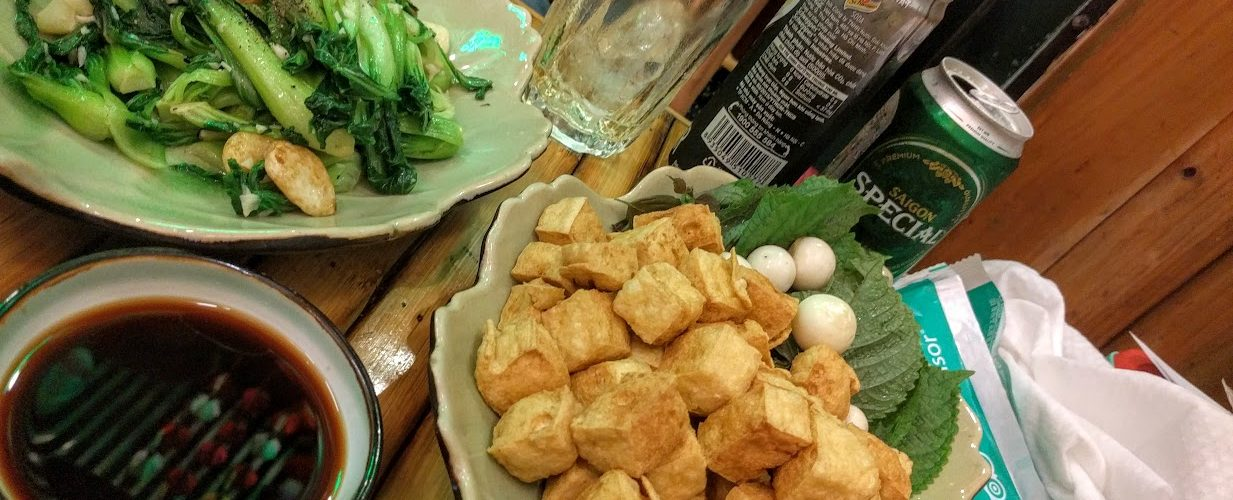 A local starter tofu and fried veggies with beer in Saigon Foodie Tour