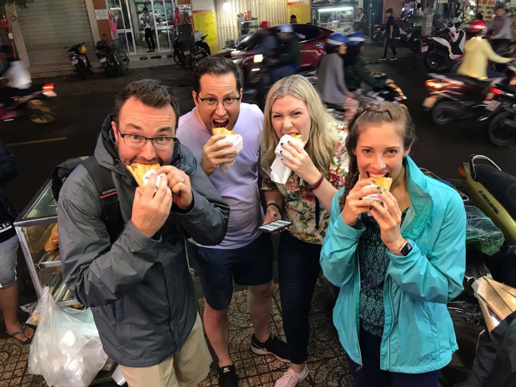 Our happy customers enjoy Banh Mi on Saigon Street Food Tour