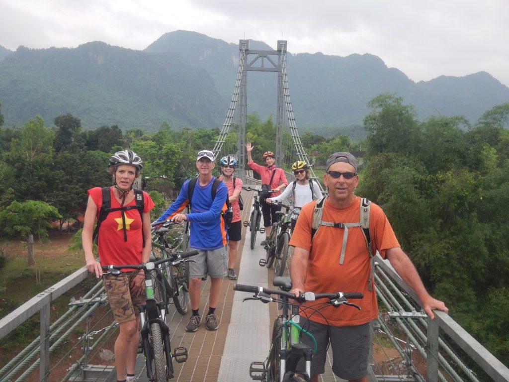 Riding bicycle through Chay village in Phong Nha National Park
