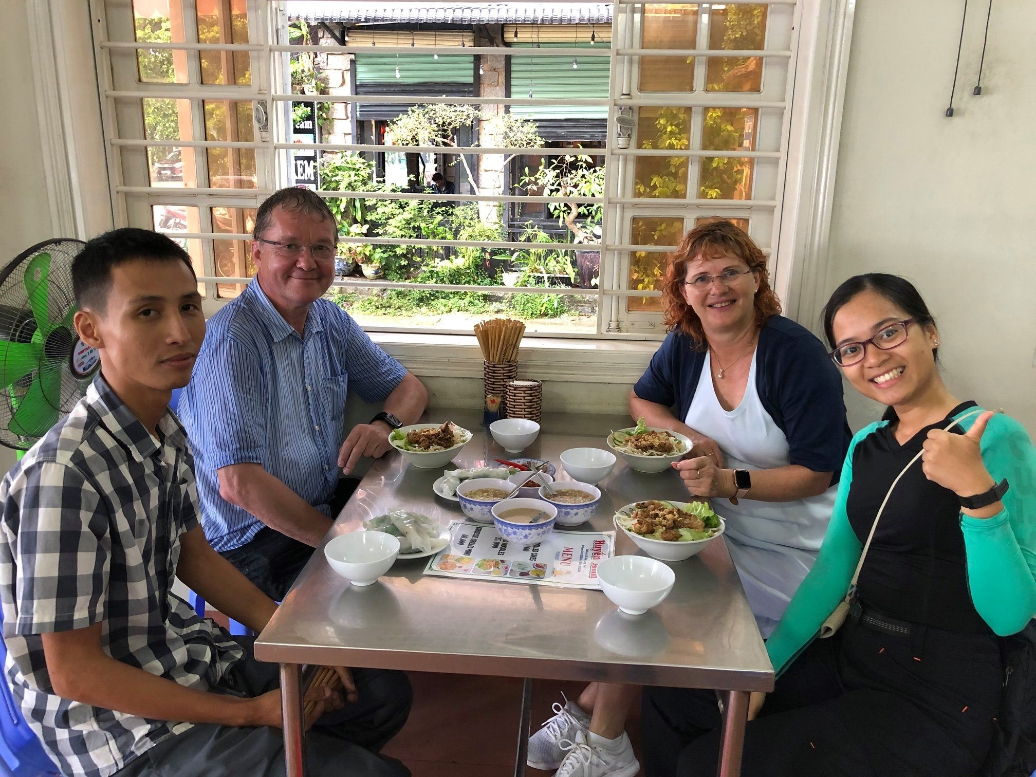 German couple, driver and I were enjoying yummy authentic food in Hue ancient capital.